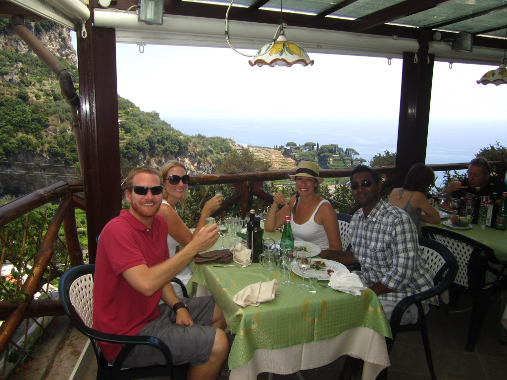 Two couples eating lunch and drinking wine