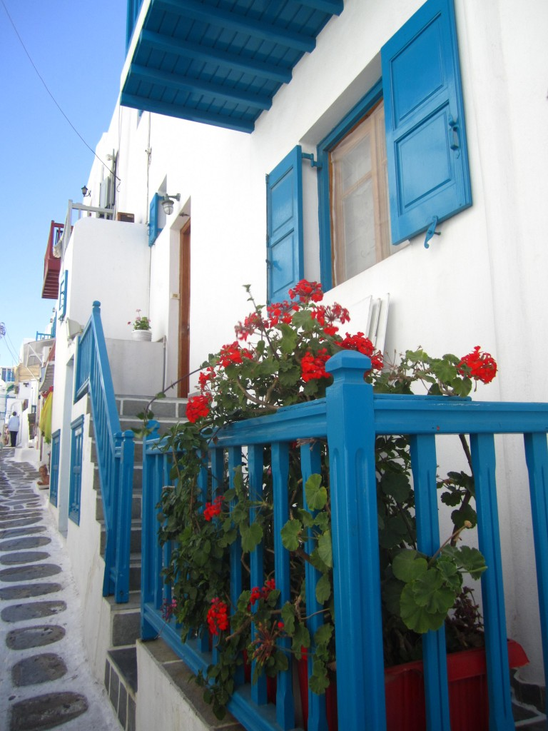 Mykonos White Stone House with red flowers