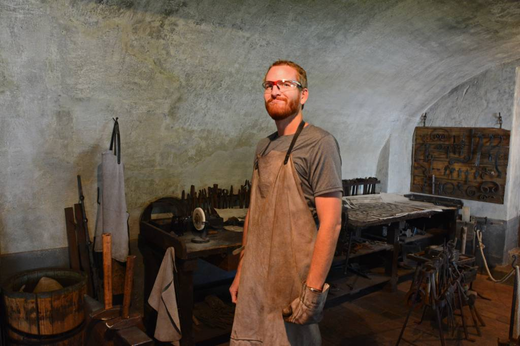 Man with beard as a blacksmith