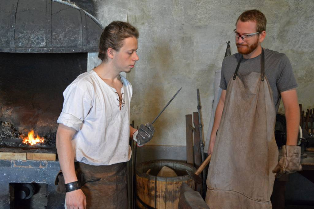 Blacksmiths inspecting their work