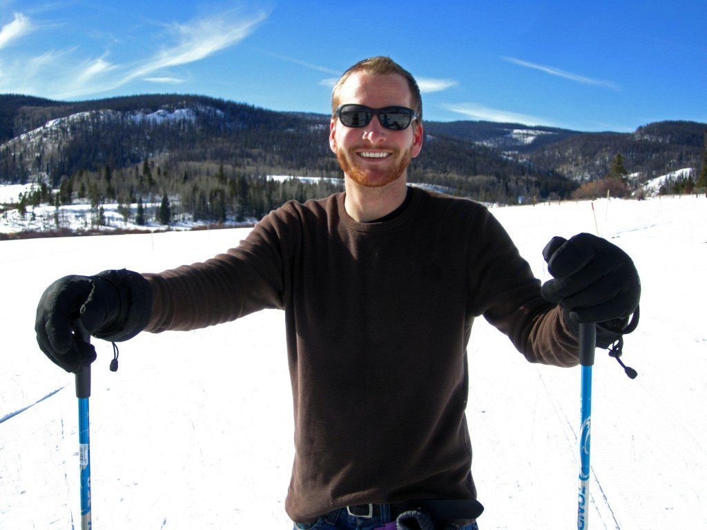 Smiling man cross country skiing