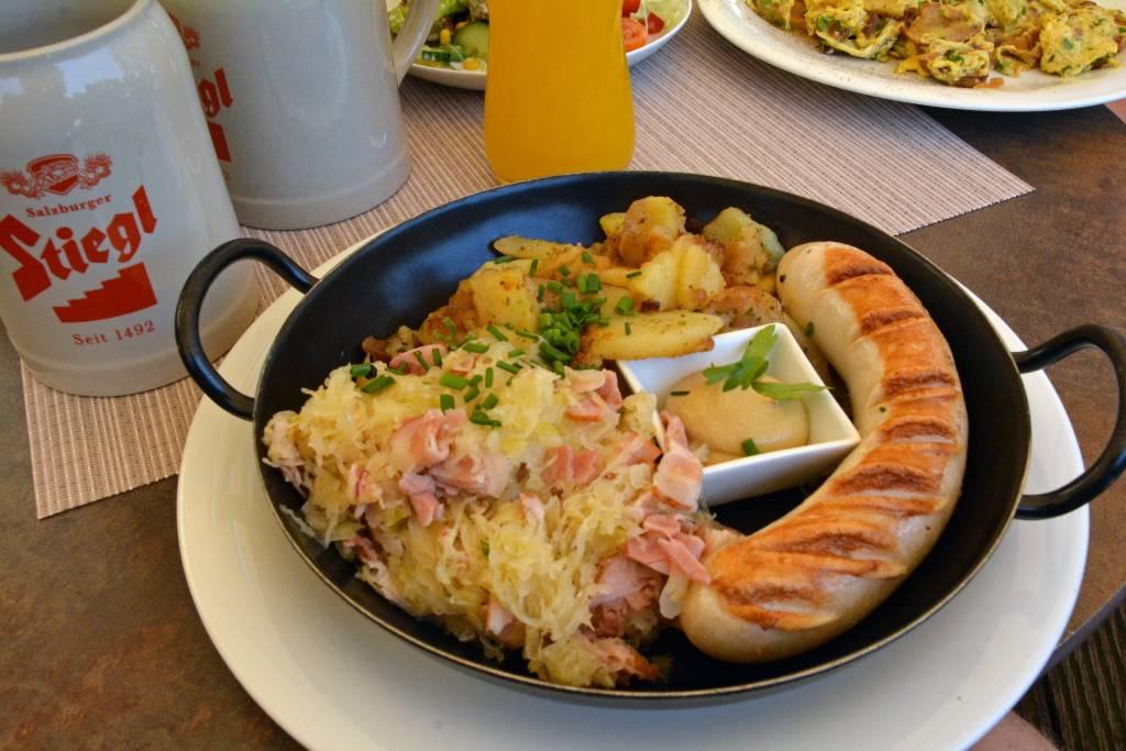 Wurst with cabbage sauerkraut and stiegl