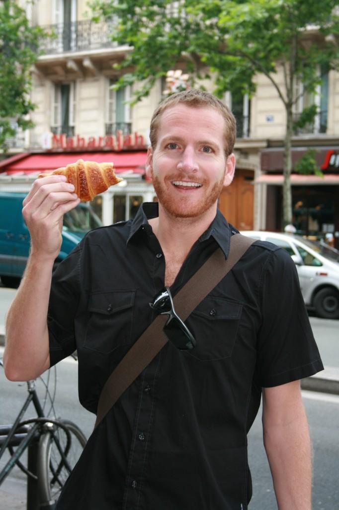 Happy tourist with croissant