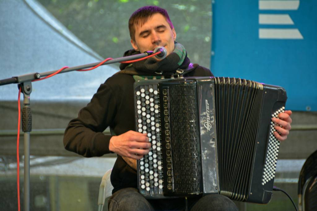 Accordion Player singing on stage