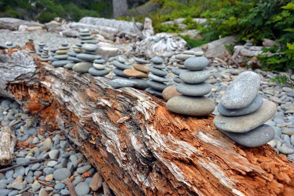 Stacked Rocks on driftwood